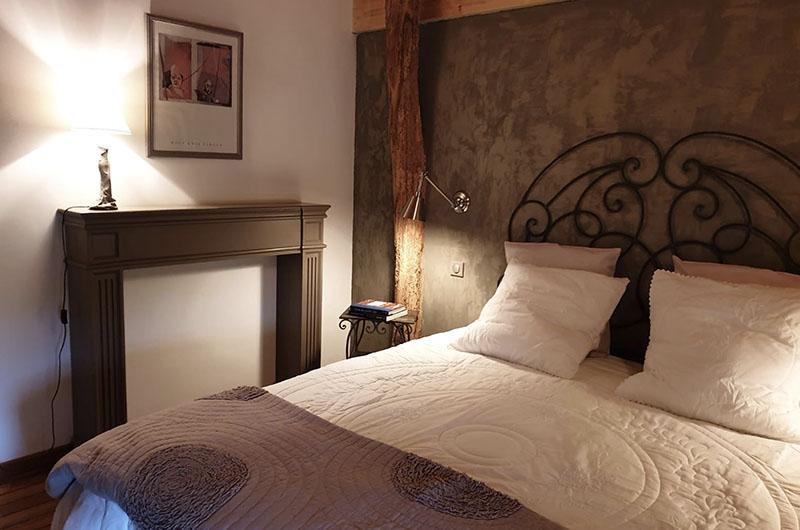 chambre de l'appartement Emilia Plaisance